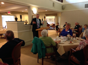 Terence O'Malley addresses a group of seniors about things to consider when choosing a retirement community.
